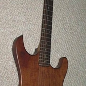 Cherry solid body guitar